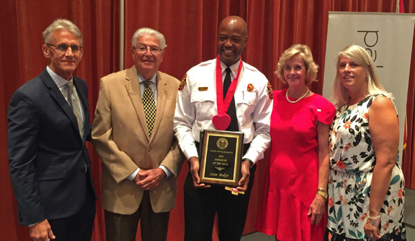 Fire-Rescue Division Chief Sean Baker receiving the Palm Beach Employee of the Year Award