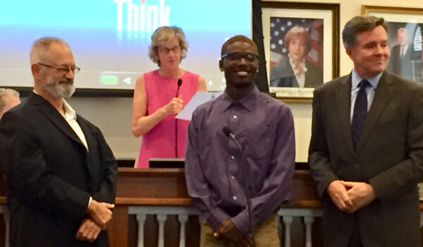 Harry Wolin of the Citizen's Association, Mayor Gail Coniglio, scholarship recipient Jaquan Starling, and John Cregan of the Civic Association. Photo by Michele Dargan.